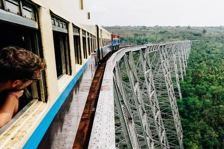 Gokteik Viaduct is a railroad bridge in Myanmar with Train Stock Photo