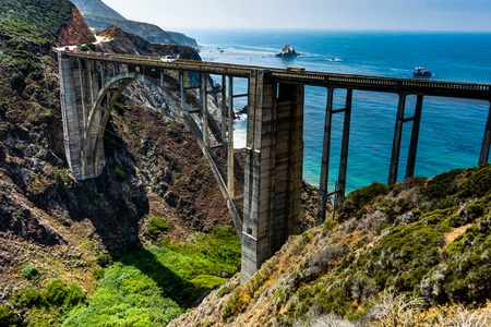 Bixby Bridge with Ocean View and water with blue sky in California Stock Photo