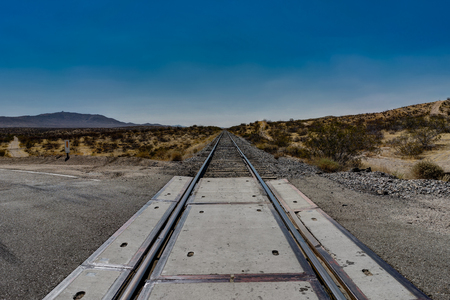 fixed line: Tracks with blue sky in Death Valley National Park California Nevada