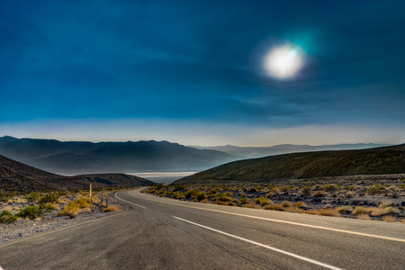 Empty Street with blue Sky and Clouds in Death Valley National Park