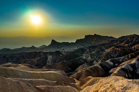 Zabriskie Point sunset with sky in Death Valley National Park California Stock Photo