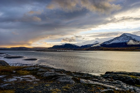 Atlantic Ocean with snow capped mountains and Icelandic Landscap Stock Photo