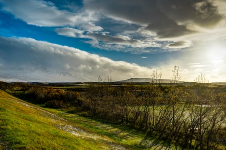 Icelandic Landscape with blue sky and sun and clouds with mounta Stock Photo