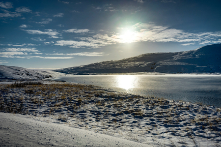 Chrismas Winter Landscape with Sun blue Sky and Snow in Iceland