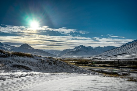 Iceland winter landscape view with blue sky and sunlight cold fr