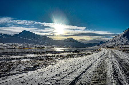Iceland snow covered street in winter landscape view with blue s