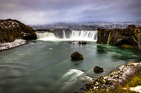 Godafoss Water Fall in Iceland during Winter snow frozen cloudy