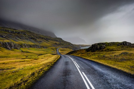 Empty Street with Icelandic Landscape during with misty mountain Stock Photo