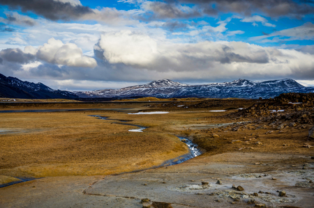 Hverir geothermal area near Myvatn Iceland with clouds and sky a