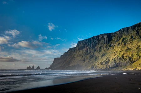 Black Beach and Sea-stacks in Vik Iceland with mountains waves a Stock Photo