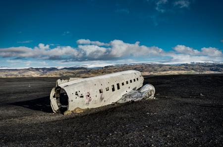 Airplane wreckage Solheimasandur Iceland on black sand beach