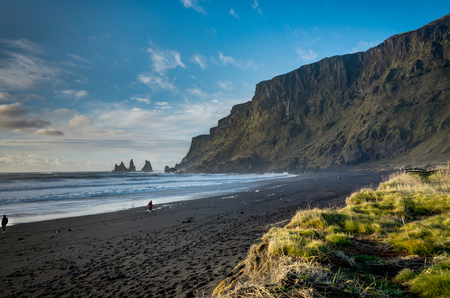 Tourist Person at Black Beach and Sea-stacks in Vik Iceland with