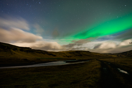Northern lights Aurora Borealis above landscape in Iceland Stock Photo