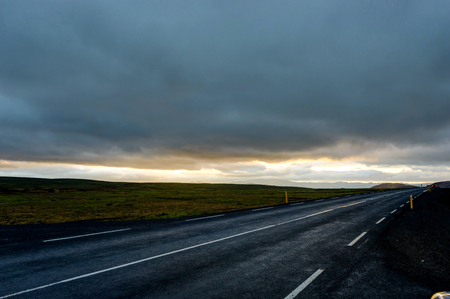 fixed line: Empty Street with Icelandic Landscape during Sunrise Golden Hour