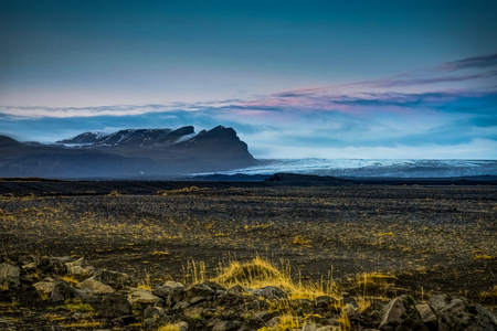 Vatnajokull Glacier covered in fog with mountains and blue sky Stock Photo
