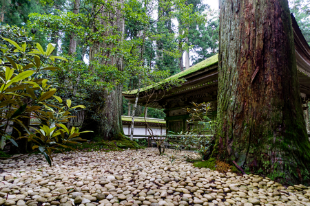 Japanese Traditional Building Temple Shrine with white gravel Stock Photo