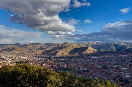 View over Cusco Peru with blue sky and clouds Stock Photo