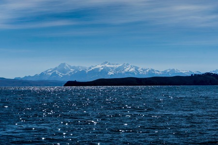 Water and Snow Capped Mountains in Background Lake Titicaca