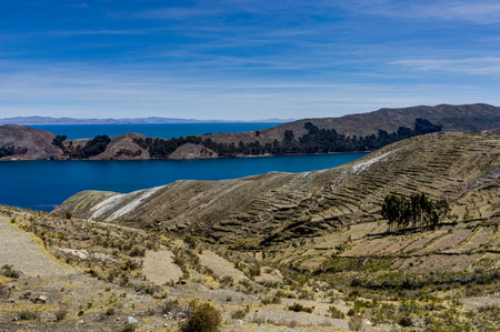 View across La isla del Sol with blue Sky water and trees lake. Stock Photo