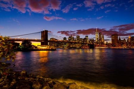 New York Skyline with Brooklyn Bridge Hudson River Manhatten Twi