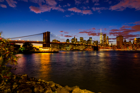 New York Skyline with Brooklyn Bridge Hudson River Manhatten Twi
