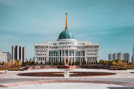 Presidential palace Ak-Orda with blue sky across river in Astana, Kazakhstan