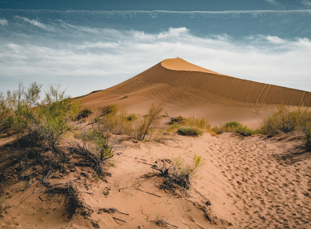 Sand dunes under blue sky. Sahara Desert, Previously, village houses transferred due to sands movement. 写真素材