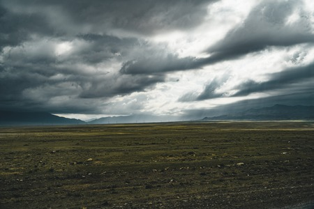 empty Kazakhstan Steppe view with green landscape and mountains in background
