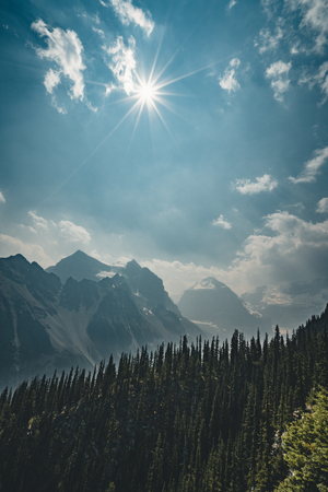 Sunstar over Mountain Panorama in Banff National Park - Alberta,