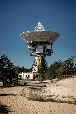 A huge soviet radio telescope near abandoned military town Irbene in Latvia. Former super-secret Soviet Army space spying object.Now largest radio telescope in northern Europe and the worlds eighth largest. Stock Photo