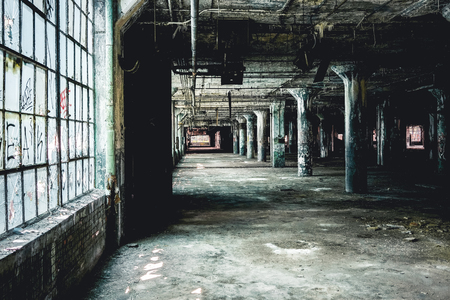 Interior view of the abandoned Fisher Body Plant factory in Detroit. The plant is abandoned and vacant ever since. 免版税图像
