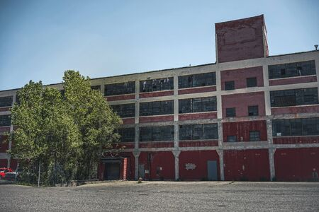 Exterior of abandoned factory in Detroit, Michigan. Large deserted building. Editorial