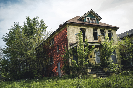 Detroit, Michigan, May 18, 2018: Abandoned and damaged single family home near downtown Detroit.