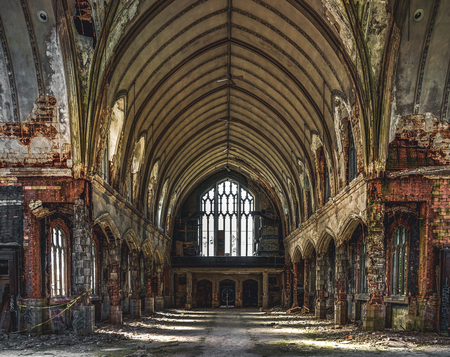 Detroit, Michigan, May 18, 2018: Interior view of abandoned and damaged Church St. Agnes in Detroit. Stock Photo - 132492535