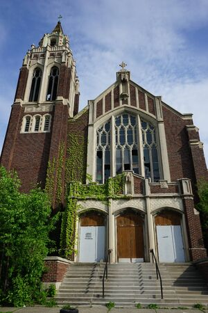 Detroit, Michigan, May 18, 2018: Outside view of abandoned and damaged Church St. Agnes in Detroit. Stock Photo - 132492480