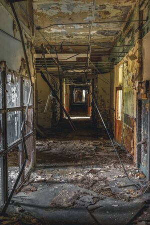 Detroit, Michigan, May 18, 2018: Interior view of abandoned and damaged George Ferris School in Detroit. Like other schools in Highland Park, Ferris went into a decline in enrollment numbers that it never recovered from, and closed in the late 90s. There  Stock Photo - 132492482