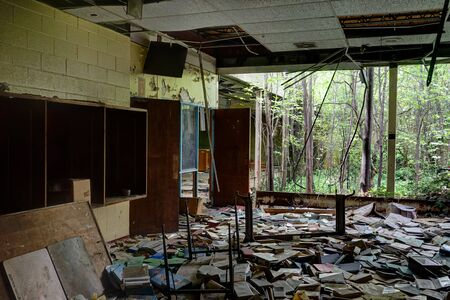 Detroit, Michigan, May 18, 2018: Interior view of abandoned and damaged George Ferris School in Detroit. Like other schools in Highland Park, Ferris went into a decline in enrollment numbers that it never recovered from, and closed in the late 90s. There  Stock Photo - 132492489