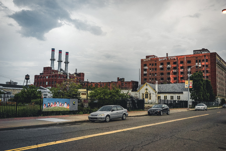 Detroit, Michigan, May 18, 2018: View towards typical Detroit Automotive Factory with water tower and Chimney. Stock Photo - 132492476