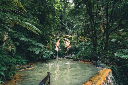 Waterfall in Caldeira Velha, ribeira grande, Natural Spa, Sao Miguel, Azores, Portugal Imagens - 127424565
