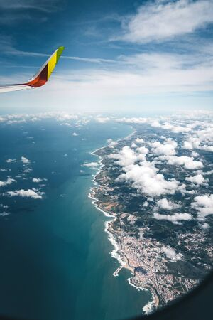 Lissabon, Portugal - July 15, 2019: Boeing 737 aircraft operated by Tap Airlines flight over the coast of Portugal Lissabon region . Aerial view through the airplane window