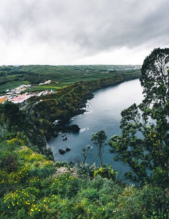 North coast Landscape over Capelas town on Sao Miguel island, Azores archipelago, Portugal. Miradouro do Porto das Capelas.