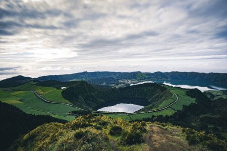 Landscape of Sete Cidades from Mirador da Boca do Inferno at sunset with lagoa de Santiago, Sao Miguel, Azores Islands, Portugal Imagens - 127424776