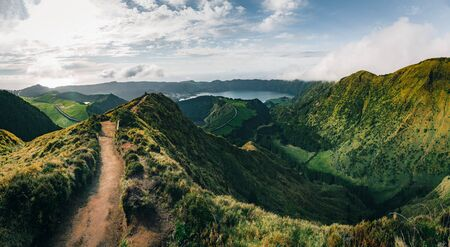 Landscape of Sete Cidades from Mirador da Boca do Inferno at sunset with lagoa de Santiago, Sao Miguel, Azores Islands, Portugal