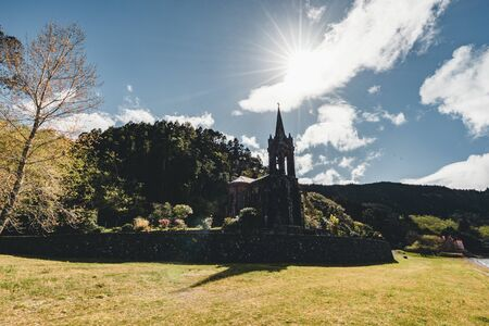Very old church near crater lake Furnas on Sao Miguel Island named Chapel of Nossa Senhora das Vitorias. Perish of Furnas. On the largest volcanic island in the Portuguese of the Azores Imagens