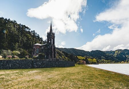 Very old church near crater lake Furnas on Sao Miguel Island named Chapel of Nossa Senhora das Vitorias. Perish of Furnas. On the largest volcanic island in the Portuguese of the Azores Imagens - 127424854