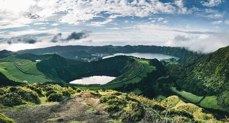 Landscape of Sete Cidades from Mirador da Boca do Inferno at sunset with lagoa de Santiago, Sao Miguel, Azores Islands, Portugal Imagens - 127424891
