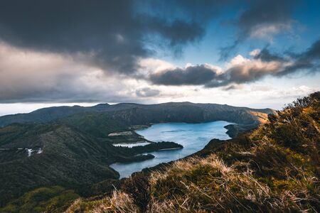 Beautiful panoramic view of Lagoa do Fogo, Lake of Fire, in Sao Miguel Island, Azores, Portugal. Sunny day with blue sky and clouds. Imagens