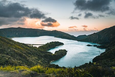 Beautiful panoramic view of Lagoa do Fogo, Lake of Fire, in Sao Miguel Island, Azores, Portugal. Sunny day with blue sky and clouds. Imagens - 127424912