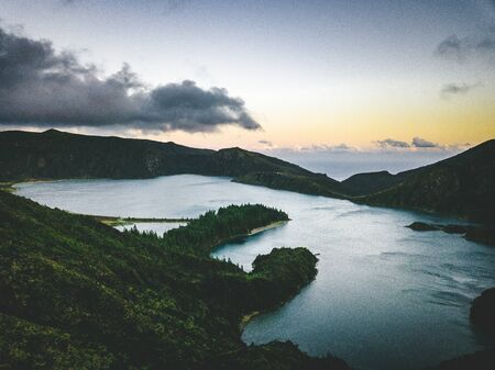Sunset over Beautiful panoramic view of Lagoa do Fogo, Lake of Fire, in Sao Miguel Island, Azores, Portugal. Sunny day with blue sky and clouds.