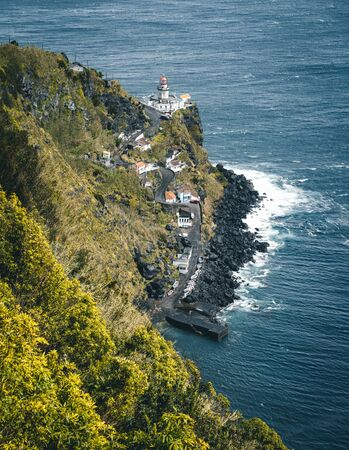 Dramatic view down to lighthouse on Ponta do Arnel, Nordeste, Sao Miguel Island, Azores, Portugal Imagens
